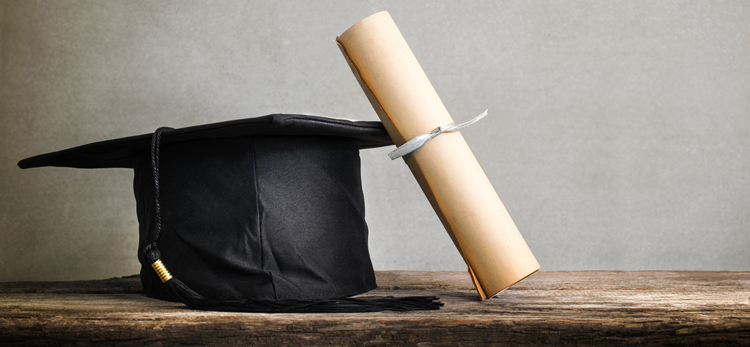cap and gown; Online Accelerated Bachelors to Masters Program